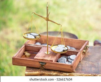 Balance with coins of the Roman Empire