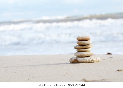 Balance or harmony concept Stack of pebbles at sea coast