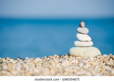 Balance and Harmony Pyramid of pebbles at beach