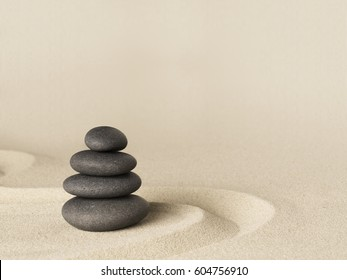 Balance and harmony, zen stone garden background. Dark black stones on fine sand standing for concentration and relaxation.