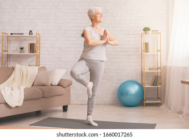 Balance in life. Senior woman doing yoga tree pose at home, free space - Shutterstock ID 1660017265