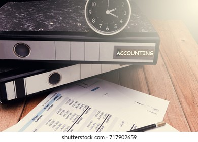 Balance sheet ,pencil, clock,file,telephone,coffee on accountant's desk. Accounting , accounts concept.