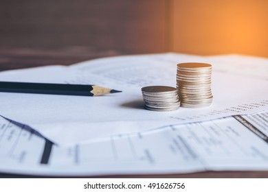 Balance sheet  with pencil and coins on bank Statement, Account concept,soft focus.