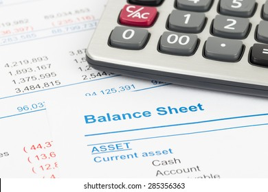 Balance sheet report with calculator; document is mock-up