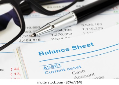 Balance sheet in stockholder report book, balance sheet is mock-up