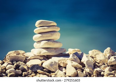 Balance and spa concept, inspiration, zen-like and well being tranquil composition. Wellness harmony, white stone pebbles stack over blue sea