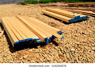 The balance of stacked and bundled 2x4s ready for use on the jobsite.