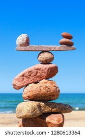 Balance stones against the sea. The concept of work-life balance. Rock zen in the form of scales
