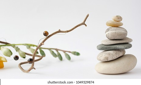 Balance of stones. Stones for spa treatments on a white background. The concept of meditation in the stones is stacked in pyramid.