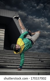 Balance stunt in an urban environment.  Selective focus on face