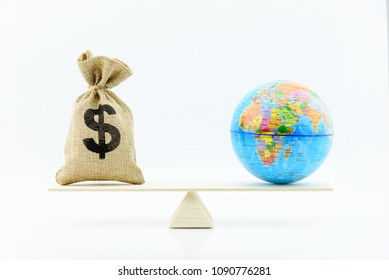 Balance of trade / commercial balance or net exports concept : US dollar bag, world globe on balance scale, depicts the difference between the value of a country imports and exports for a given period