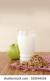 Balanced breakfast with cereals, milk and green apple
