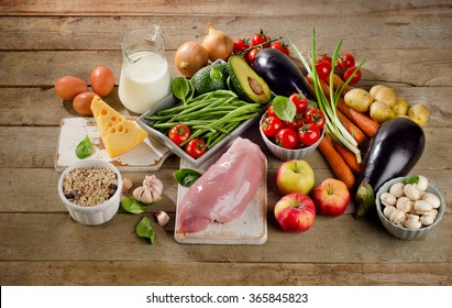 Balanced diet, cooking and healthy food concept on wooden table. View from above
