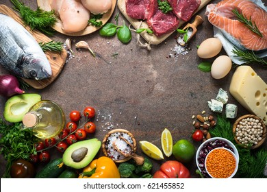 Balanced diet food background. Organic food for healthy nutrition. Ingredients for cooking. Top view copy space stone table.