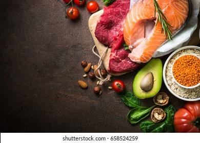 Balanced diet food background. Organic food for healthy nutrition. Ingredients for cooking. Top view copy space on dark stone table.