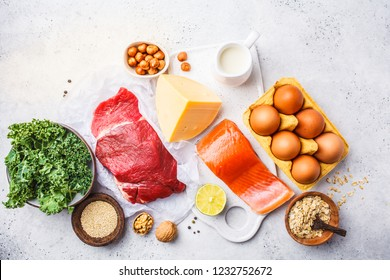 Balanced diet food background. Protein foods: fish, meat, eggs, cheese, quinoa, nuts on white background, top view, copy space.
