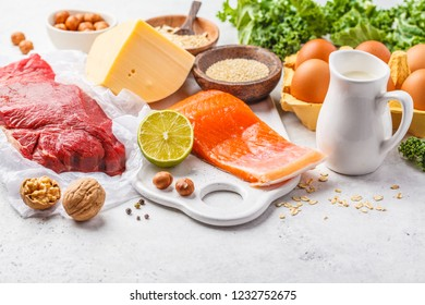 Balanced diet food background. Protein foods: fish, meat, eggs, cheese, quinoa, nuts on white background, copy space.