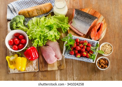 Balanced diet, healthy food concept on a wooden board. View from above