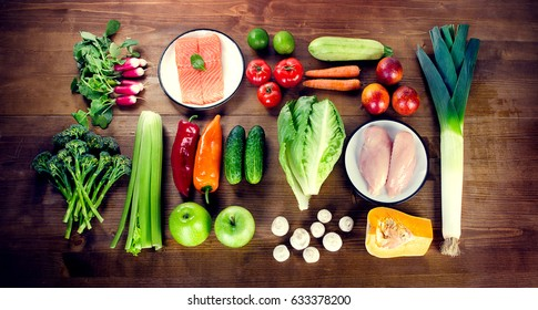 Balanced diet. Healthy food concept. Vegetables, fruits, fish and meat on wooden table. Flat lay