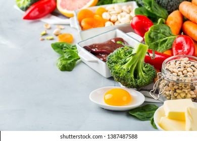 Balanced diet nutrition, healthy clean eating concept. Assortment of food sources rich in vitamin a on a kitchen table. Copy space background