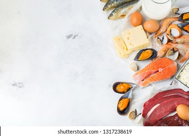 Balanced diet nutrition, healthy eating concept. Food sources rich in vitamin B12, cobalamin on a kitchen table. Top view flat lay background