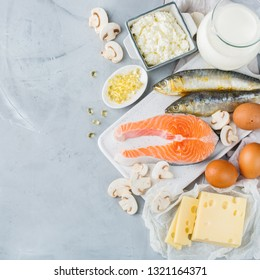 Balanced diet nutrition, healthy eating concept. Assortment of food sources rich in vitamin d, salmon, dairy products, milk, eggs, cheese, mushrooms, sardines on a kitchen table