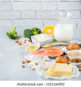 Balanced diet nutrition, healthy eating concept. Assortment of food sources rich in vitamin d and calcium, salmon, dairy products, sardines, broccoli on a kitchen table