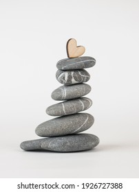 Balanced gray zen pebbles on white background. Zen stones. Spa and healthcare concept.