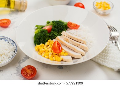 Balanced meal or diet concept. Chicken with rice and vegetables