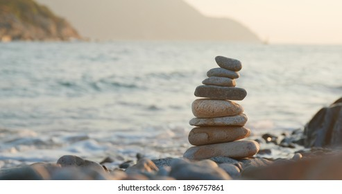 Balanced Pebble stone at beach in sunset time