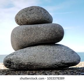 Balanced Pebbles On A stone Beach