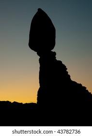 balanced rock back lit at sunrise