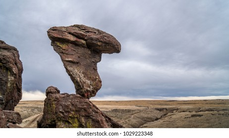 Balanced Rock Formation with a Cloudy Sky