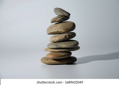 Balanced small stones on the floor with plain background