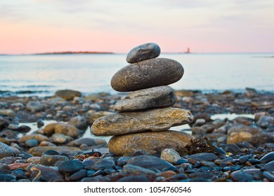 Balanced Stack of Rocks Near the Ocean at Sunset