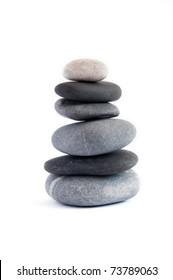 Balanced stack of stones isolated on white. Zen design concept