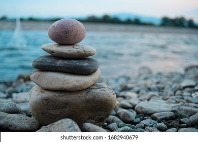 balanced stones and river backgroung/stone pyramid
