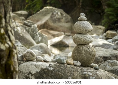 balanced stones in riverbed