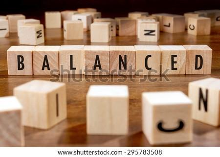 balanced word written on wood block stock photo edit now 295783508