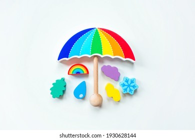 Balancer toys on a white isolated background. Children's wooden toy in the form of an umbrella. Educational logic toys for children. Montessori Games for child development.