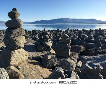Balancing cairn of stones at the coastline of Reykjavik