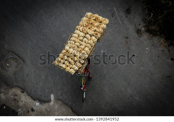 Balancing delivery of bread on a bike in Cairo, Egypt /Middle East