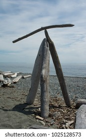 Balancing driftwood design on beach in Washington.