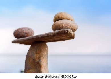Balancing of pebbles on the top of stone