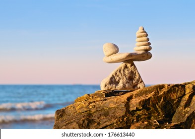 Balancing of pebbles on the top of triangle stone