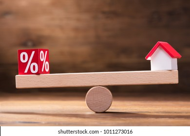 Balancing Of Percentage Red Block And House Model On The Small Seesaw