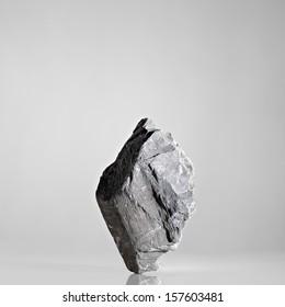 Balancing Rock on Grey Background