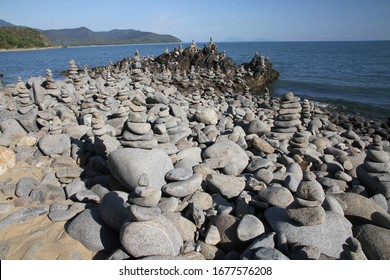 Balancing rock sculpture on the beach along the Captain Cook Highway north of Cairns in Queensland Australia.