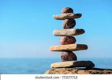 Balancing several of stones on the seashore