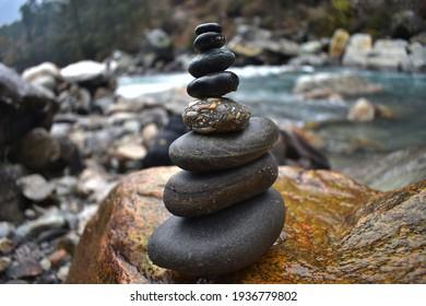 Pile of balancing smooth pebbles rocks